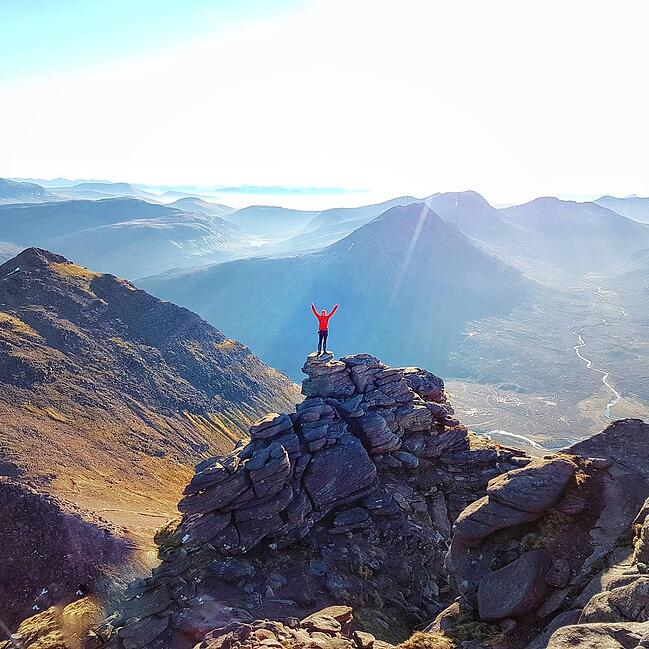 Emma Louise Crome standing on top of mountain Teallach for Fresh Air Friday