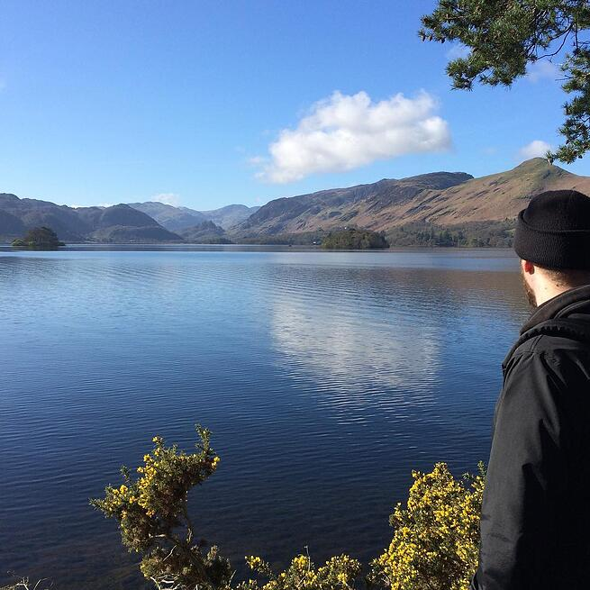 A lone male figure looks out over Derwentwater in the Lake District