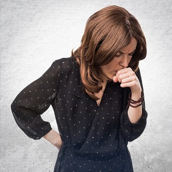 Woman coughing from chest infection