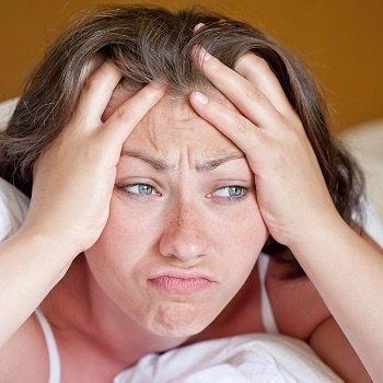 insomnia symptoms effecting a woman