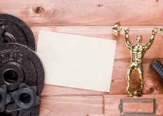 Bodybuilding trophy alongside loose weights