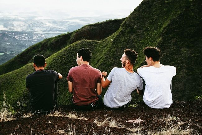Friends laughing on a hill