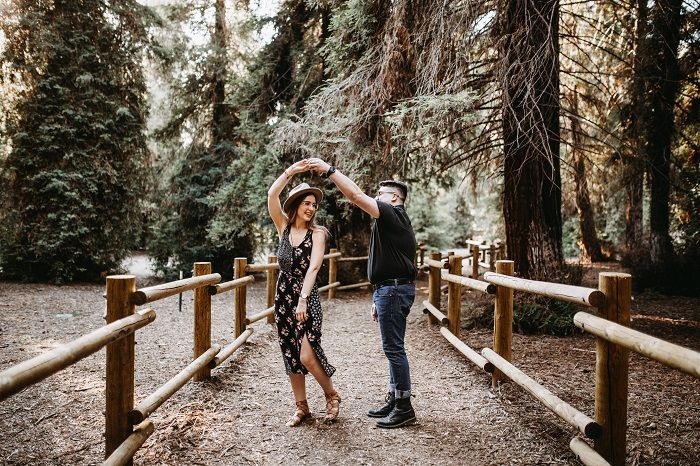 Couple dancing in a forest