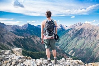 Man looking out over mountains