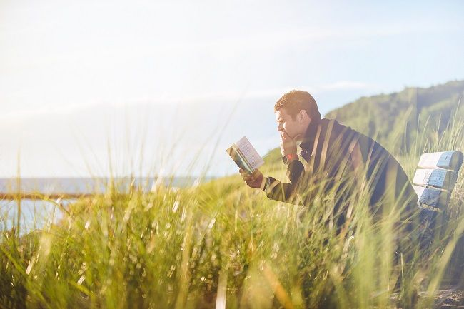 Man reading and getting some fresh air - two healthy habits in one!
