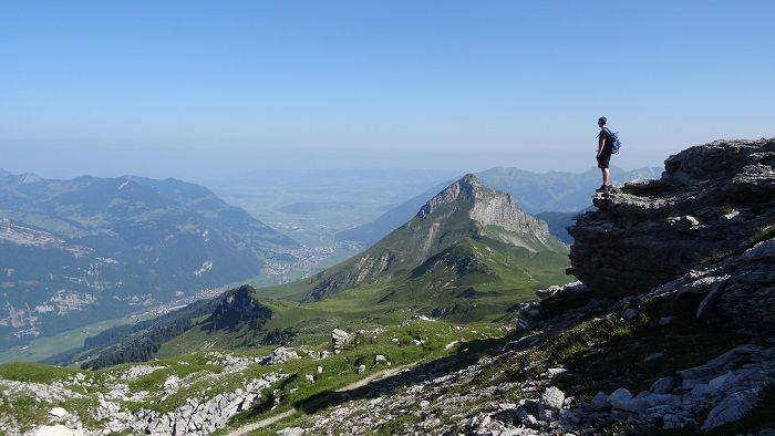 Man walking up a mountain