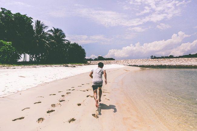 Man running along beach