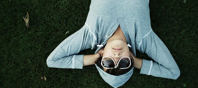 Man sleeping in sunglasses on the grass