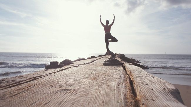 Yoga pose by the sea