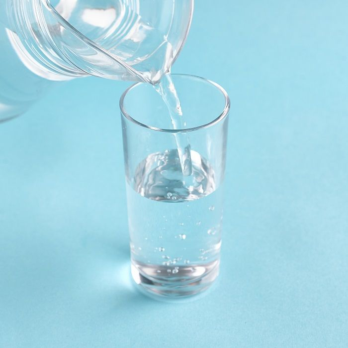 Glass of water poured from a jug