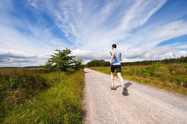 Man running down a road