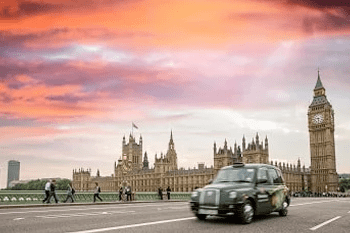 London taxi driving across Westminster Bridge