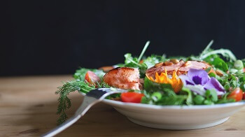 Salmon on a bed of salad