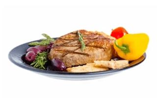Grilled pork fillet served with peppers and black olives