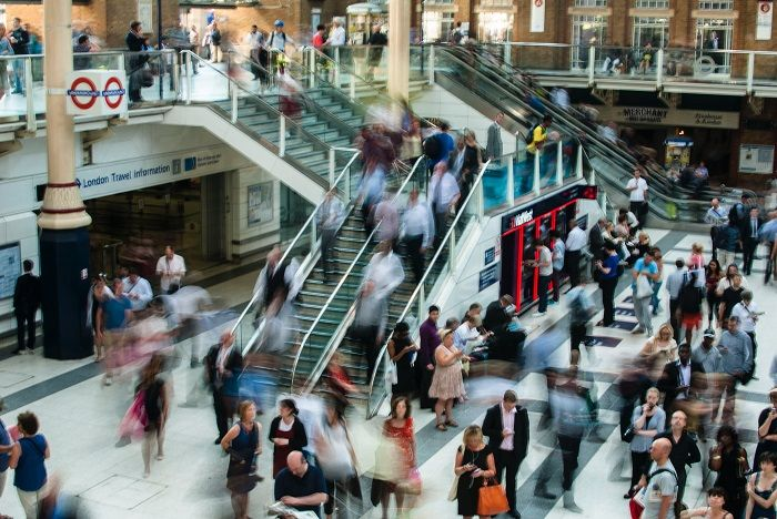 A large crowd at a London train station