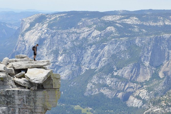 Man on a high mountain, looking down