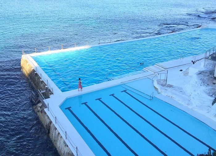 A swimming pool next to the sea