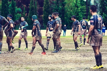 A game of rugby on a muddy pitch