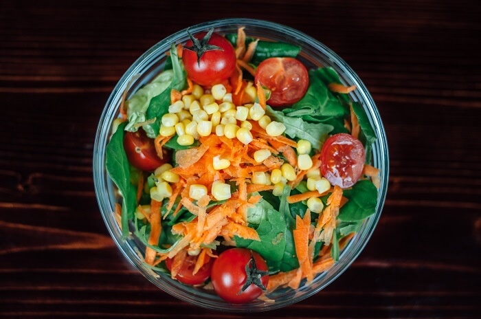 salad bowl with tomato, carrot and sweetcorn