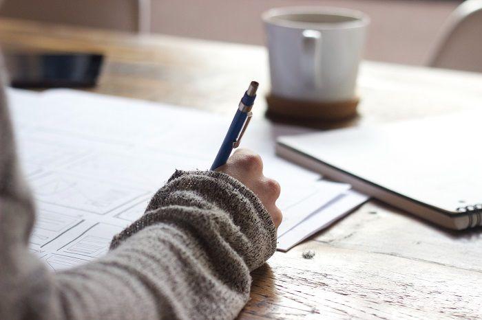 Person writing down their feelings