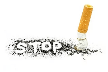 "The word ""stop"" spelt out in ash alongside a stubbed cigarette"