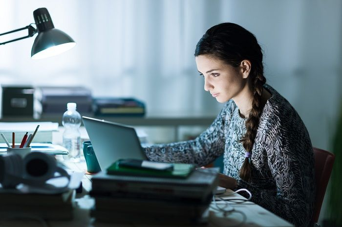 Student working in a quiet spot to avoid distractions