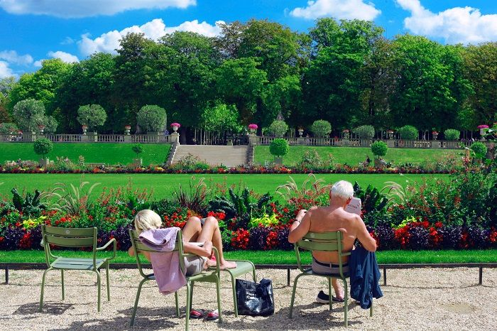 People relaxing in a sunny garden
