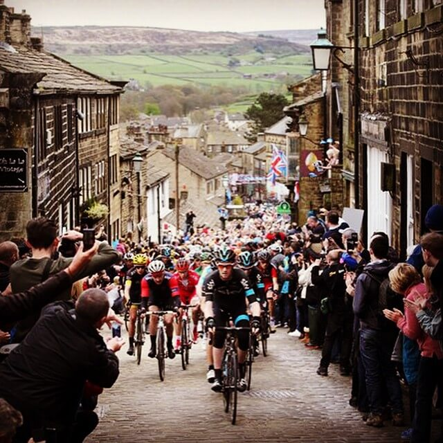 Numerous cyclists riding through Haworth Street for the Tour de Yorkshire, Fresh Air Friday inspiration.