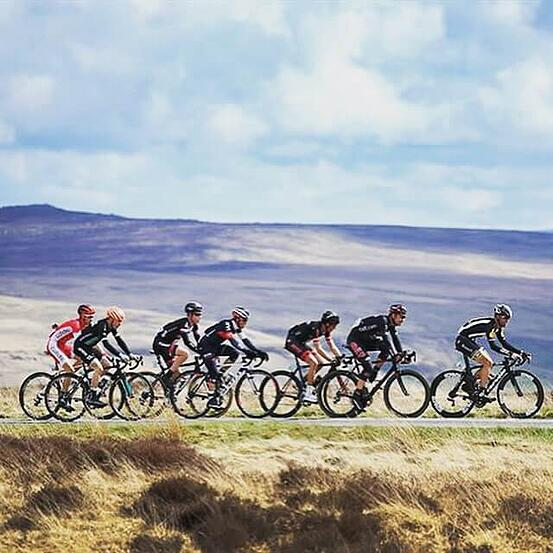 Several cyclists riding across the Yorkshire moors for the Tour de Yorkshire themed Fresh Air Friday.