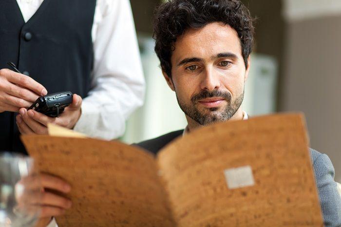 Man looking at menu