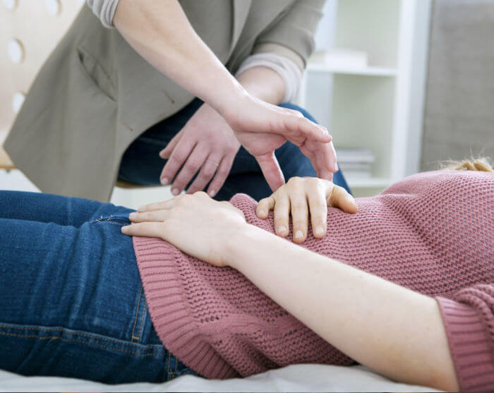 hypnotherapist working on a person