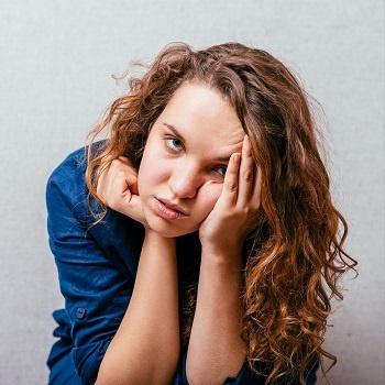 Woman suffering from glandular fever symptoms