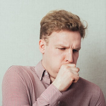 Man coughing due to chest infection