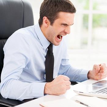 Angry man at desk
