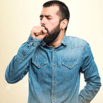 Man coughing due to bronchitis