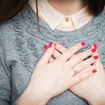 Woman holding her chest in pain