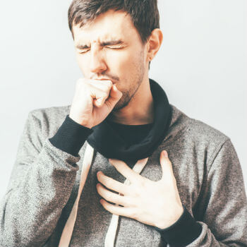 Man coughing with pneumonia