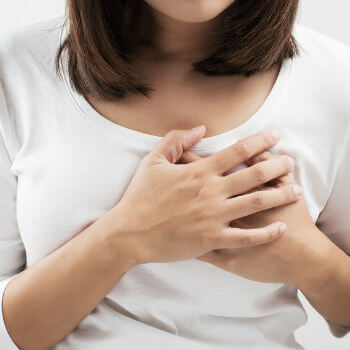 Woman experiencing an irregular heartbeat