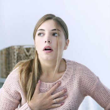 Woman having heart palpitations