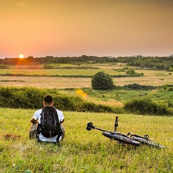 Man with bike on a hill