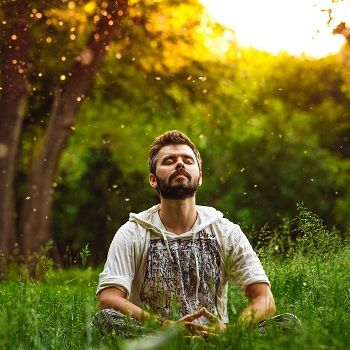 Man doing breathing exercises in a field