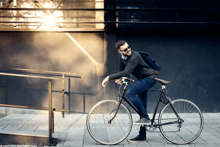 Happy cycling male hipster