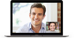 Man smiling on laptop