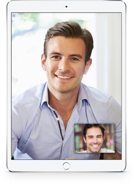 Man smiling on tablet