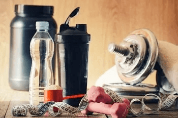 Selection of bodybuilding equipment with protein shaker and water bottle